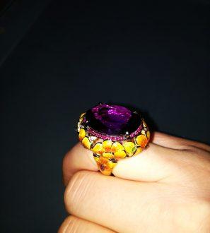 Кольцо 27.7 грамм золото 750 пробы. Центральный камень : аметист 23 карата
